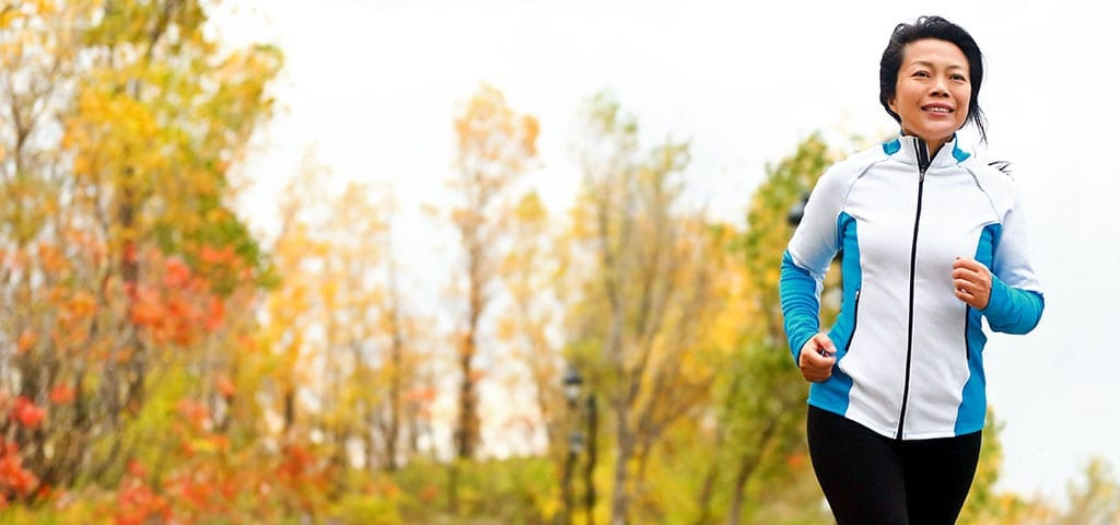 Woman on a morning run in the fall