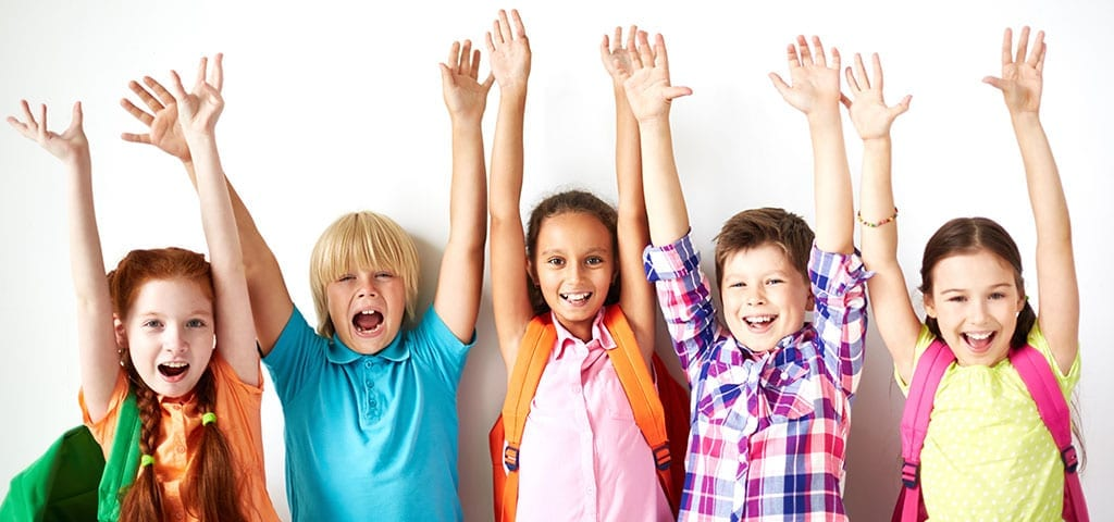 Kids raising their hands for school