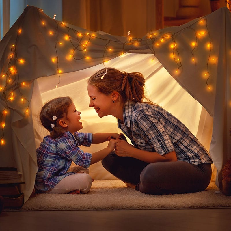 Mother and Child under a blanket fort