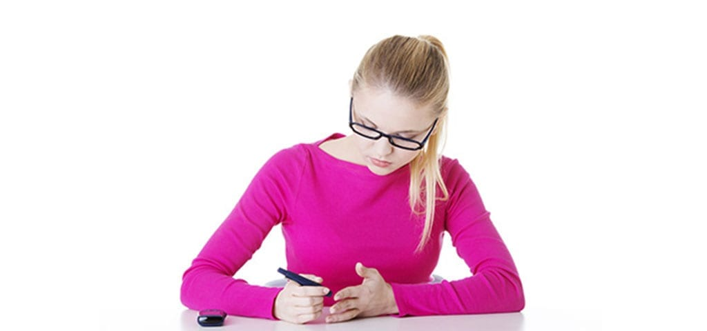Teenager checking glucose