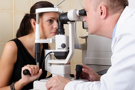 Diabetic woman having her eyes checked