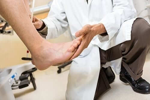 doctor looking at patients foot