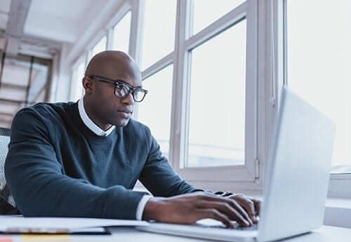 Man Searching on Computer