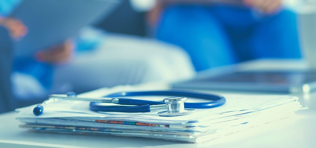 Stethoscope on medical files