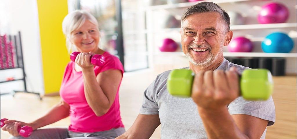 Elderly people exercising together