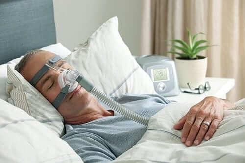 Man Using a CPAP Machine