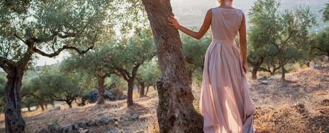 Girl Standing Next- To Tree