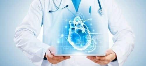 Doctor with digital heart blueprint