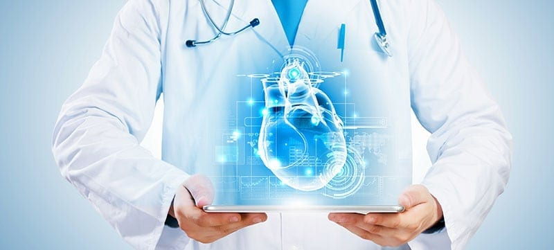 Doctor with digital heart blueprint