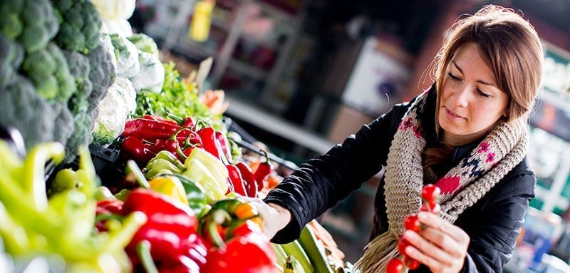Woman picking out fresh vegetables
