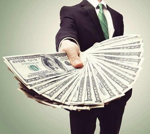 Businessman Holding Hundred Dollar Bills