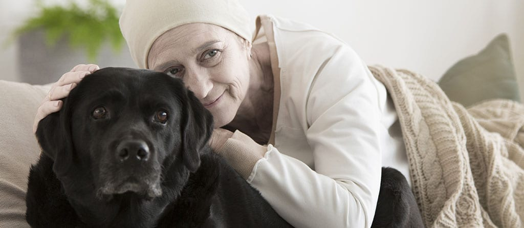 Woman with Cancer and Her Lab
