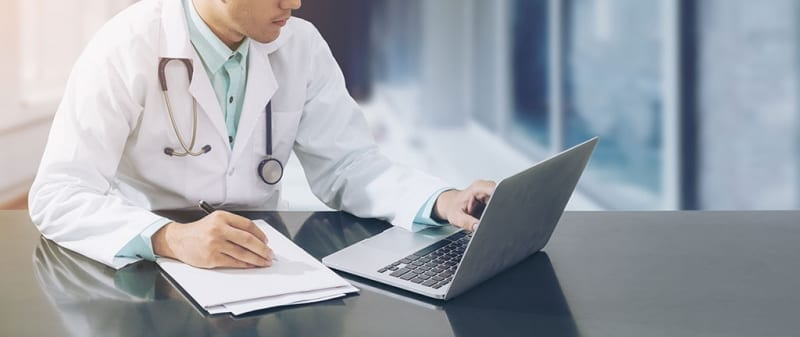 Doctor looking at laptop screen