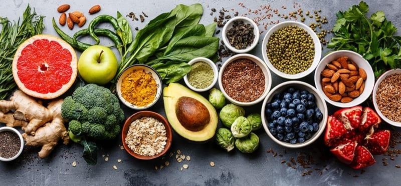 Summer fruit and vegetables on blackboard