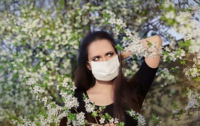 Woman Wearing Facemask to Prevent COVID-19